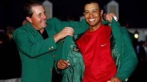 Phil putting the Green Jacket on Tiger